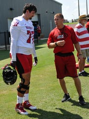 UL offensive tackle Grant Horst talks with Cajuns strength coach Lewis Caralla during a preseason practice.
