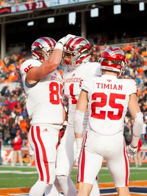 Hoosiers wide receiver Simmie Cobbs Jr. (1) celebrates with tight end Ryan Watercutter (85) and wide receiver Luke Timian (25) after a touchdown catch during the fourth quarter against the Illinois Fighting Illini at Memorial Stadium.