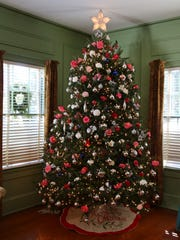 The Christmas tree in Maclay House is decked out with blooms for the Camellia Christmas at Maclay Gardens.