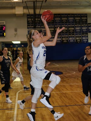 Gateway eighth-grader Addison Potts drives to the basket in a game against Oasis. Potts has college scholarship offers from 6 Division-I programs.