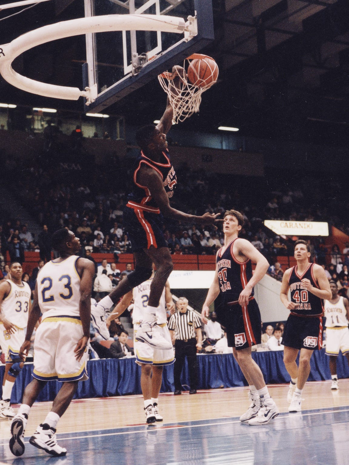 USI's Stan Gouard dunks during the 1994 Elite Eight. He was named the Chevrolet Player of the Game in the national title game.