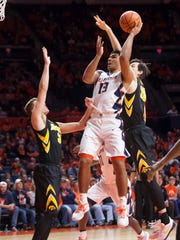 Illinois guard Mark Smith (13) shoots against Iowa