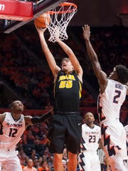 Jan 11, 2018; Champaign, IL, USA; Iowa Hawkeyes forward Luka Garza (55) shoots while defended by Illinois Fighting Illini forward Kipper Nichols (2) during the second half at State Farm Center. Mandatory Credit: Mike Granse-USA TODAY Sports
