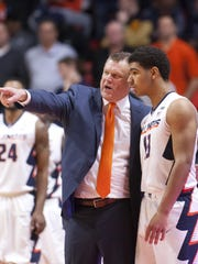 First-year Illinois coach Brad Underwood, who spent last season as Oklahoma State's head coach, instructs Illini freshman Mark Smith, who nearly came to Michigan State.
