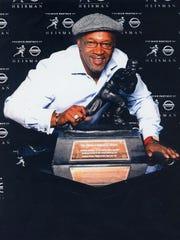 Former pro football player Mike Rozier, a Woodrow Wilson High School alum, was New Jersey's first Heisman Trophy winner.