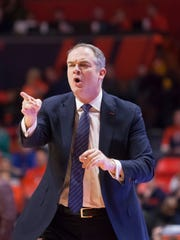 Rutgers Scarlet Knights head coach Steve Pikiell reacts