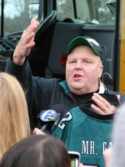 Mount Laurel School District bus driver Gary Kelmer holds his specialized Eagles jersey on Monday. Kelmer was surprised by Mount Laurel community members with a trip to the Super Bowl in Minneapolis this weekend.