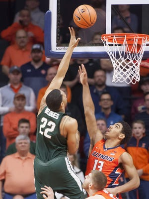 Miles Bridges scored 31 points in the last meeting between the Spartans and Illini, including two here over former MSU recruit Mark Smith, during an 87-74 MSU win on Jan. 22 in Champaign, Illinois.