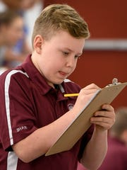 South Middle School student Harrison Shaw records his