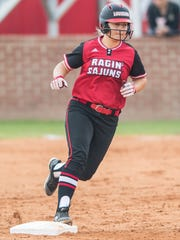 UL catcher Lexie Comeaux rounds the bases after one of her home runs during the season.