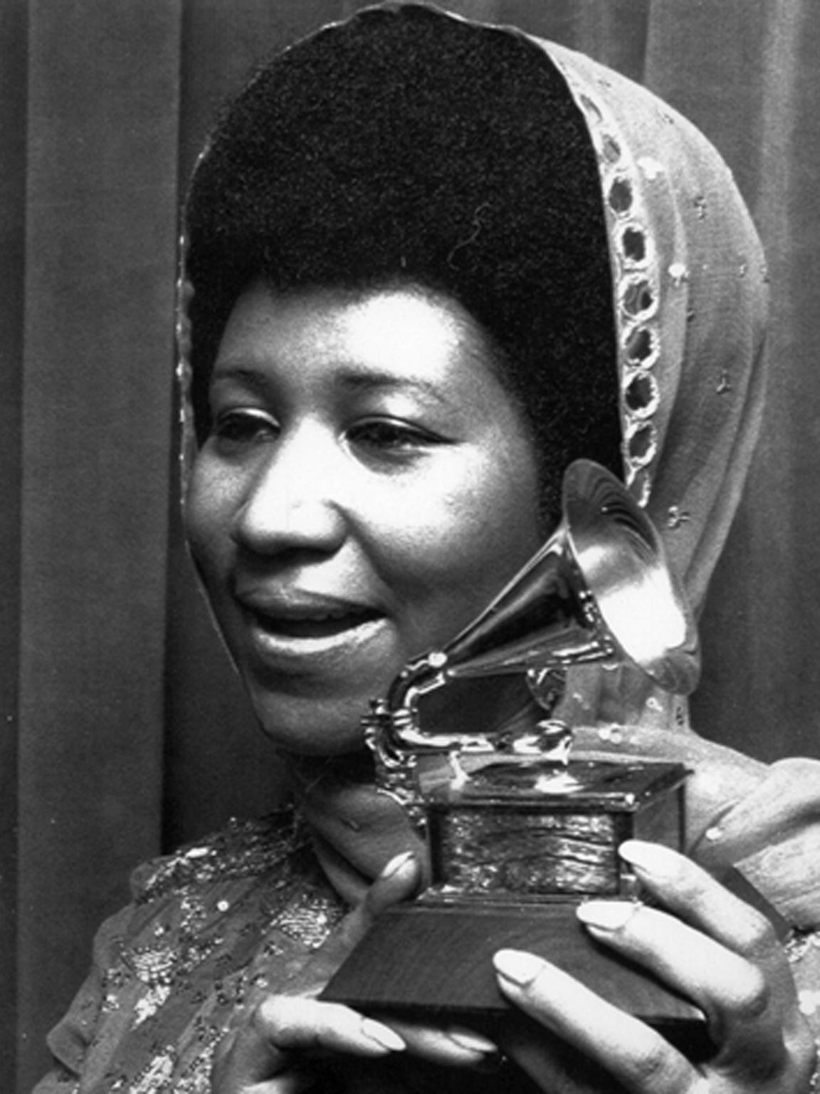 Franklin holds her Grammy March 15, 1972, after she