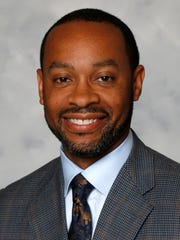 Jamal Smith was an adviser to former Gov. Mitch Daniels and former athletics director for Indianapolis Public Schools.