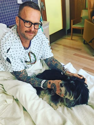 Bob Harper's dog Karl visited him in the hospital after his heart attack last year.