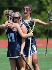 MND Midfielder Kaitlin Young gets congratulated after scoring a goal by teammates Tori Luckhaupt [17] and Rachel Harmon after scoring a goal against Sycamore.