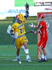 Mariemont Captain Cole Harden signals after scoring in the boys Division II regional final between Indian Hill and Mariemont High School at Mason High School. Mariemont defeated Indian Hill 5-2.