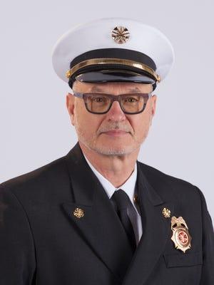 Retiring Gates fire chief Gary Swanson.