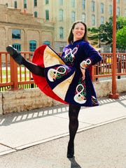 Traditional Irish dresses like this one modeled by instructor Trea Champagne often reveal where a family came from in Ireland as well as the dancing expertise of the wearer.  Some can cost up to $3,500.