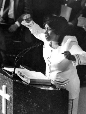 """Gospel singer Aretha Franklin sings """"He'll Understand, He'll Say Well Done"""" during the funeral of Army Specialist Anthony Riggs in 1991."""