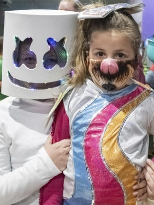 Dressed as a neon marshmallow, Logan Shirey stands with his sister Laney Shirey at the Trunk or Treat event held Sunday evening at Sky Trampoline Park in Salina.