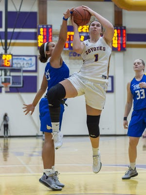 Kansas Wesleyan's Kelcey Hinz (1) puts up a shot against Tabor's Alyvia Owens (43) during Saturday night's game at Mabee Arena.