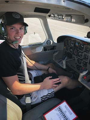 This photo provided by Steve Johnson shows Steve Johnson posed in a plane in Eden Prairie, Minn., in a Sept. 2019 photo. When the pandemic put hockey on ice, many minor league players started planning for what's next. Steve Johnson got his commercial pilot's license.