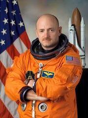 In this handout image provided by NASA, astronaut Mark E. Kelly poses for a photo January 5, 2005 in Houston, Texas.