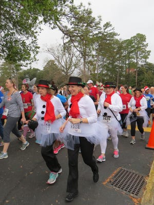 """These """"high society"""" walkers drew admiring glances from """"plain"""" participants in Saturday's annual Jingle Bell Run/Walk for Arthritis event at Huntingdon College."""