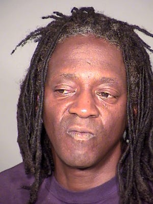 William Drayton Jr. aka Flavor Flav after his arrest in Las Vegas. Authorities say they arrested the entertainer shortly after midnight on Thursday, May 21, 2015, in Las Vegas for driving under the influence, speeding, possessing less than an ounce of marijuana and having an open container of alcohol in the 2005 black BMW he was driving.