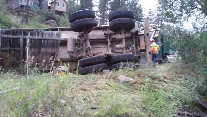 Homeowner Robert Breckenridge took this photo Friday morning of a tanker truck that rolled over near his home in the Poudre Canyon on Thursday night.