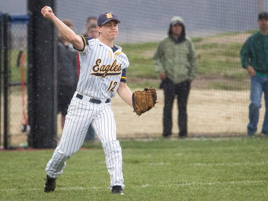Delta's Jacob Van Pelt fires the ball from the outfield
