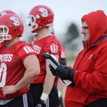 University of South Dakota football coach Joe Glenn watches a football practice early this spring in Vermillion.