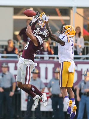 Mississippi State's Johnathan Abram (38) breaks up a pass intended for LSU's DJ Chark (7).