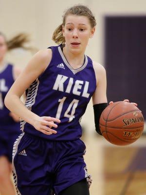 Kiel's Savannah Walsdorf (14) brings the ball up court against Sheboygan Falls on Friday in Sheboygan Falls.