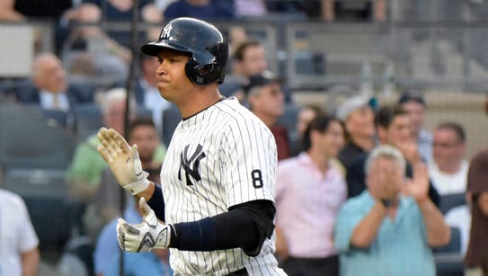 New York Yankees' Alex Rodriguez reacts as he rounds