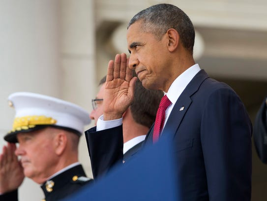 President Obama returns a salute before speaking at