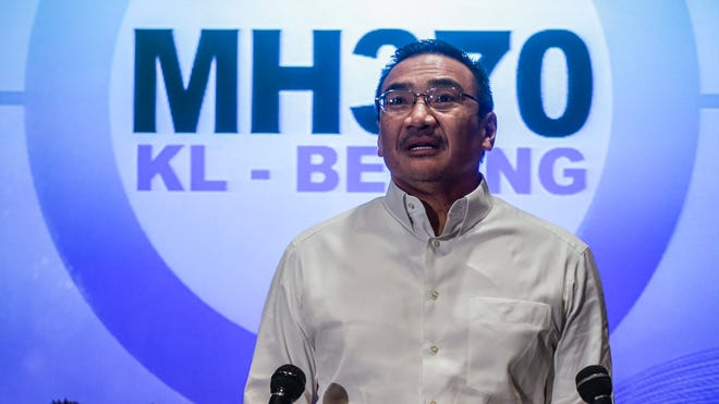 Malaysian Defense Minister Hishamuddin Hussin speaks during a press conference at Kuala Lumpur International Airport on March 16.
