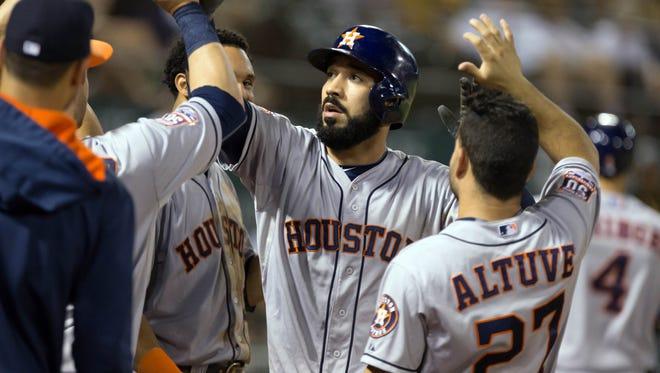 Marwin Gonzalez celebrates his home run Wednesday.