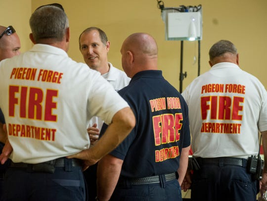 Lt. Kevin Nunn, center, of the Pigeon Forge Fire Department,