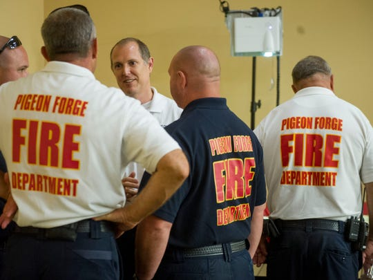 Lt. Kevin Nunn, center, of the Pigeon Forge Fire Department, talks with colleagues after a presentation of the Fire Department's partnership with Firewise USA, a program that teaches communities to better protect their homes from wildfires.