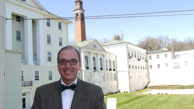 Mark Eastham, Head of School for Stuart Hall. poses in front of Fillmore Field Wednesday, April 13, 2016. The school announced they will consolidated the lower-school currently in Verona with the middle and upper schools at their Staunton Campus. A new driveway is planned to replace the field.