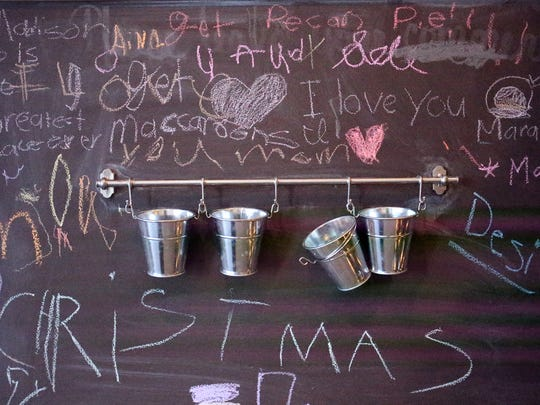 A chalk board greets patrons at the new Eastside Belle Sucre bakery at 1830 Joe Battle, Suite 103.