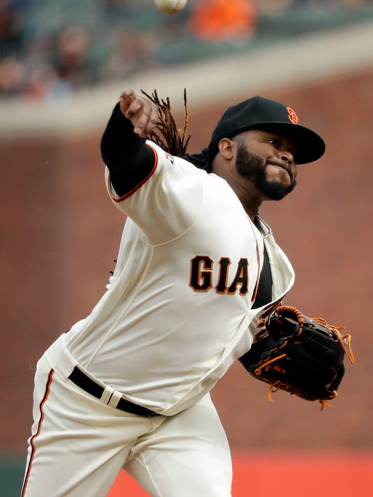 San Francisco Giants starting pitcher Johnny Cueto throws to the Seattle Mariners during the first inning of a baseball game Wednesday, April 4, 2018, in San Francisco. (AP Photo/Marcio Jose Sanchez)