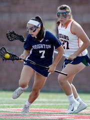 Brighton's Katie Lederman, left, carries the ball away from Manhasset's Erin Trotta during the Class B final at the NYSPHSAA Girls Lacrosse Championships in Cortland, N.Y., Saturday, June 9, 2018. Brighton's season ended with a 6-4 loss to Manhasset-VIII in the championship game.