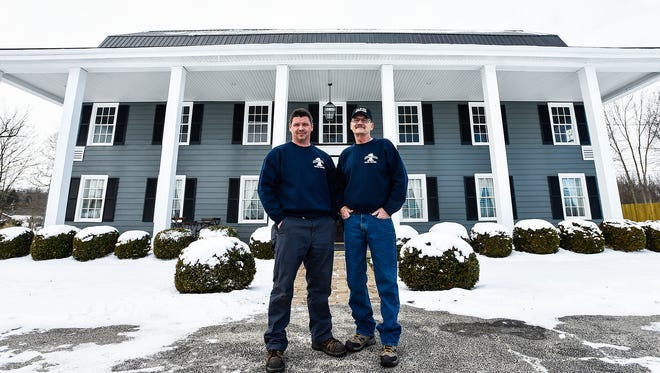 Donnie Lyons, left, and Mike Caldwell pose in front of a historic county building located at 1775 Marion-Waldo Road in 2016. It would later be known as The Loft, which caught fire this past week.