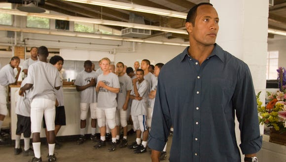 "Dwayne Johnson coaches football in ""Gridiron Gang."""