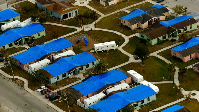 A neighborhood in Fort Pierce showed the damage caused by hurricanes Frances and Jeanne in September 2004.