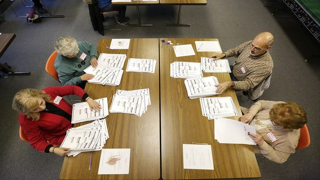 Monica Jones, Lorraine Thome, Andy Lorenz and Penny Werner count election ballots Dec. 1 at the City County Government Center in Fond du Lac during a presidential election recount. Green Party presidential candidate Jill Stein requested the recount, alleging that the state's electronic voting machines may have been hacked.