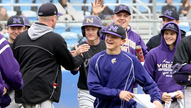 The North Kitsap dugout was all smiles after Carson Bower (center) hit his third home run of the season, driving in three runs during the Vikings' 7-3 win over Fife in a district playoff game Saturday at the Fairgrounds.