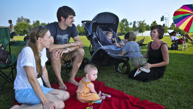People will gather on the Big Four Lawn to see the Aug. 21 solar eclipse in Louisville.
