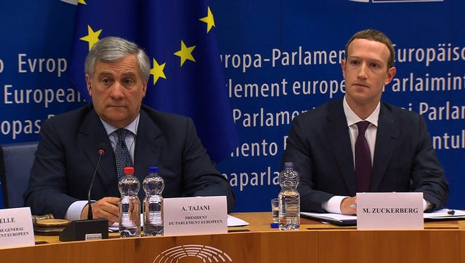 European Parliament President Antonio Tajani (L) and Facebook CEO Mark Zuckerberg (R) during a meeting on the data privacy scandal on May 22, 2018 at the European Union headquarters in Brussels.